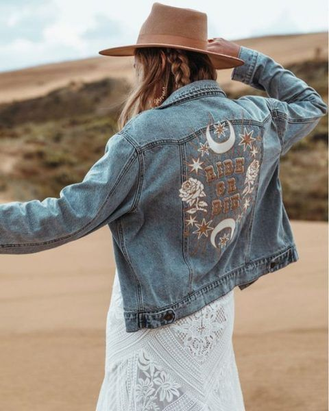 a bleached embroidered denim jacket and a hat make up a cool and chic boho look adding a free spirited feel