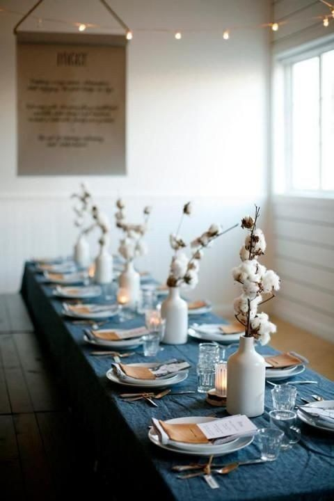 a blue chambray tablecloth and cotton centerpieces for a casual winter tablescape with no fuss