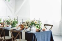 a blue chambray tablecloth gives color and texture to the tablescape and copper adds chic