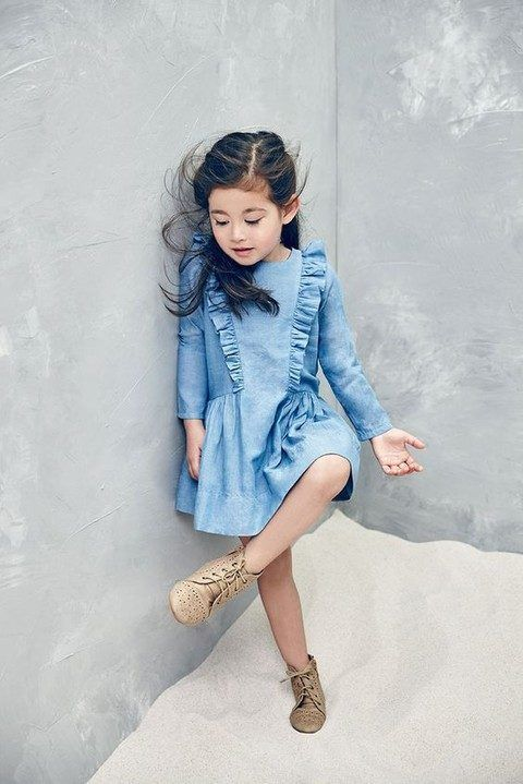 a blue denim dress with ruffles and vintage nude booties for a cute and casual flower girl look