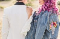a blue denim jacket with embroidery and painting is a bold and stylish way to cover up at the wedding