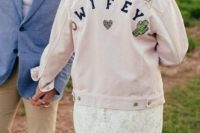 a blush oversized denim jacket with embroidery, embellishments is a bold and trendy way to cover up