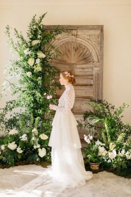a botanical wedding backdrop of lush textural greenery and white blooms, potted and not only is very refined