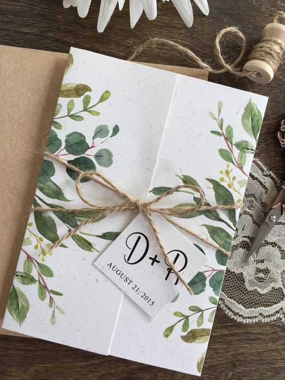 a botanical wedding invitation with botanical prints and twine with a tag is a lovely idea for spring or summer