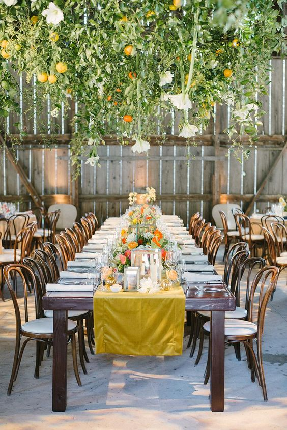 a botanical wedding reception with greeneyr, bold blooms and citrus, bright florals and linens