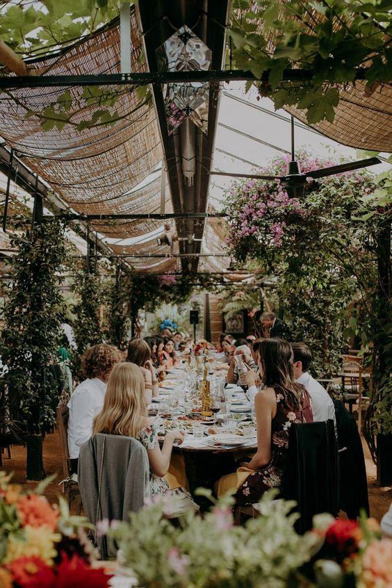 a chic botanical wedding venue with greenery and bright blooms all over the space is fantastic