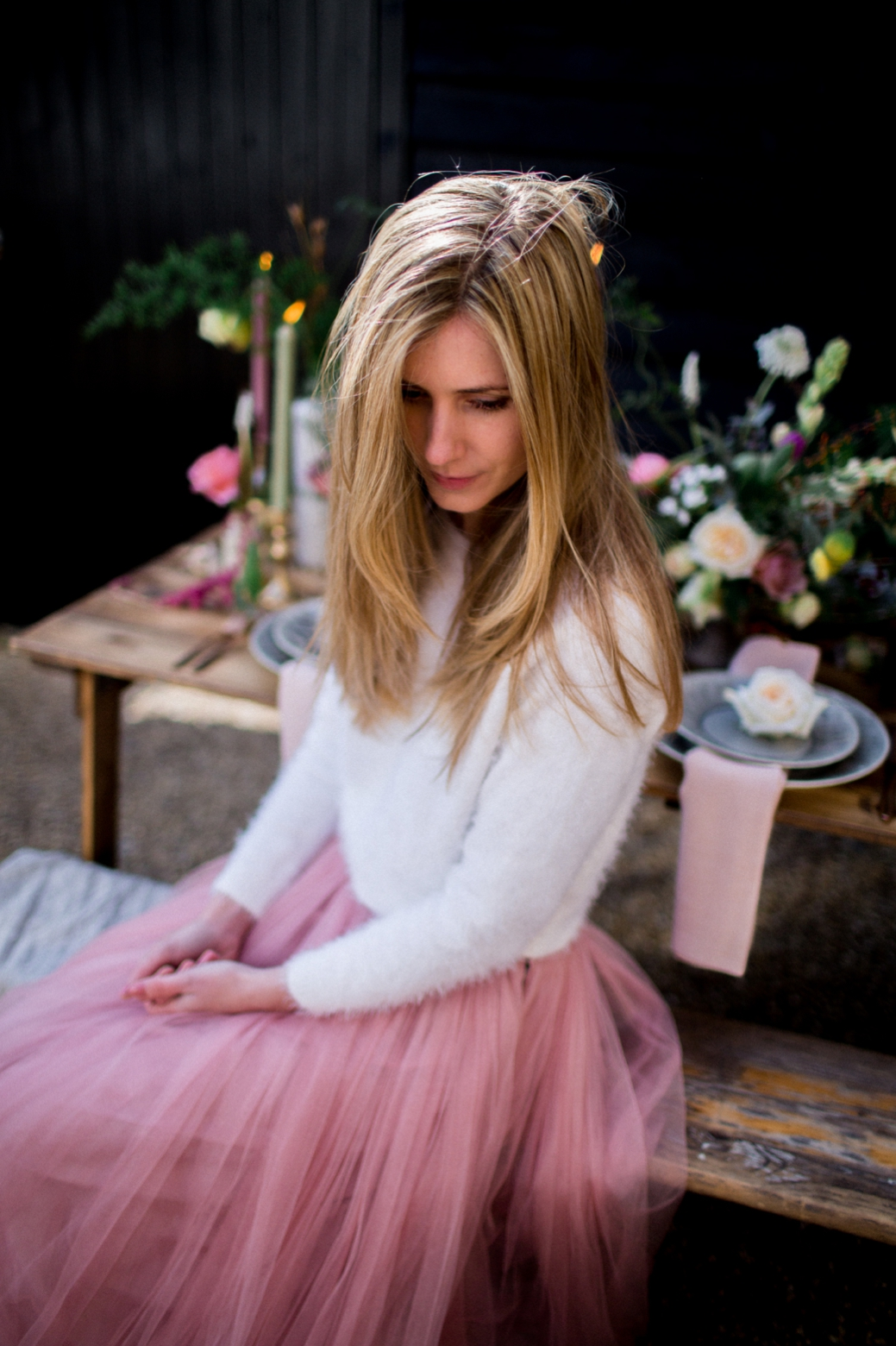 a comfy bridal look with a white fuzzy sweater and a pink tulle skirt for a casual and feminine feel