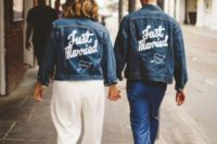 a couple wearing blue denim jackets with personalized painting looks very bold, chic and trendy