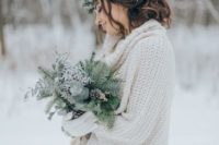 a sweater is a perfect coverup for a winter wedding