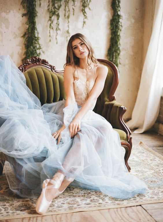 a lace bodice on spaghetti straps and a blue tulle skirt plus lace up flats for a ballerina inspired look