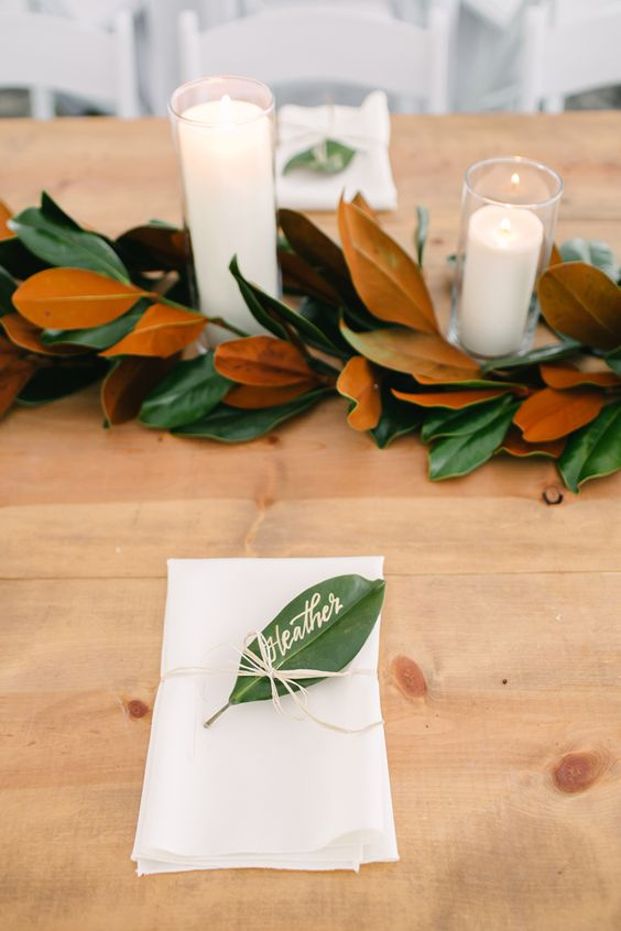 a magnolia leaf garland and a magnolia leaf card is a cool idea to style your wedding tablescape