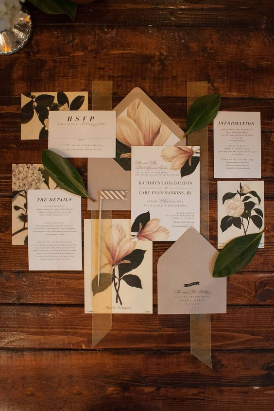 a magnolia wedding invitation suite in neutrals, with printed blooms and leaves