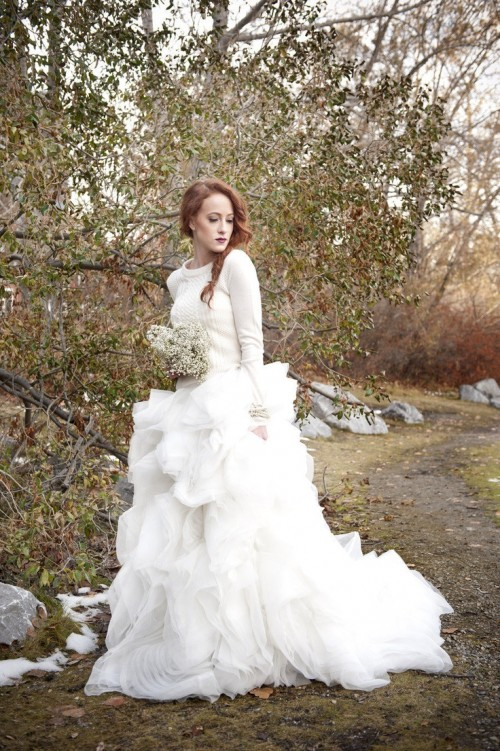 a neutral sweater over the wedding dress looks feminine and winter like