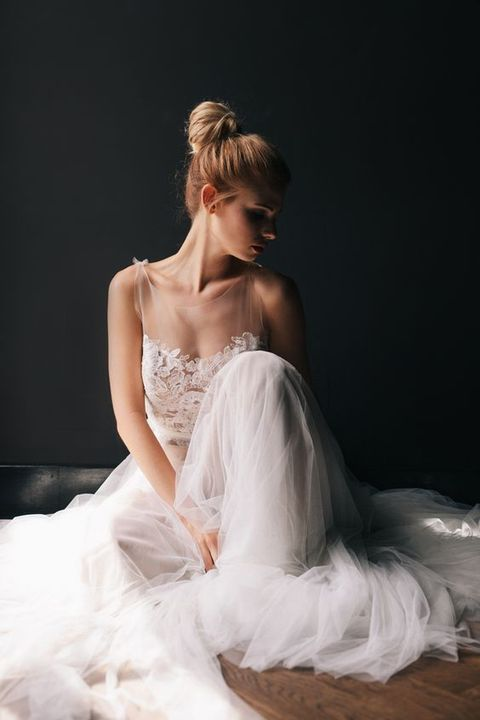 a sleeveless illusion bodice A-line wedding dress with a layered tulle skirt is gorgeous and chic