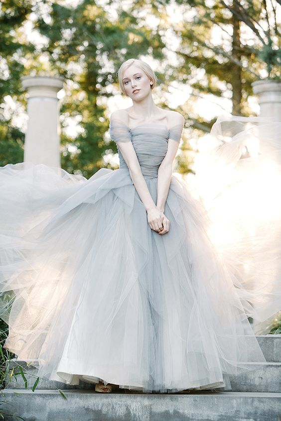 an off the shoulder slate grey wedding ballgown with a draped bodice and a layered full skirt