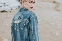 an oversized blue denim bridal jacket with letters and embellishments is a nice boho coverup