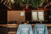 bleached blue denim jackets covering your wedding chairs will substitute usual signage and wreaths