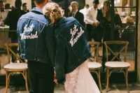 both guys wearing matching blue denim jackets with white letters as cool coverups
