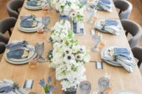 chambray napkins, cutlery pockets and matching denim cards and blue glasses for a chic and romantic wedding tablescape