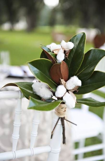 magnolia leaves and cotton will make your wedding aisle cozy and truly southern