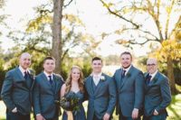 the groom and groomsmen wearing jeans and blazers for a more relaxed and fun look