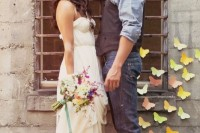 a rustic groom's outfit with a grey shirt, a brown waistcoat, navy jeans and brown shoes