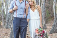 a rustic and relaxed groom's look with navy pants, a blue shirt, striped suspenders and brown shoes