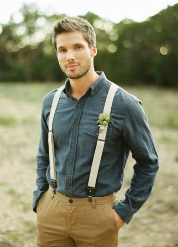 a rustic groom's look with mustard pants, a dark chambray shirt and neutral suspenders