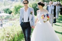 a relaxed groom's look with black pants, suspenders, a white shirt, a light blue jacket and matching sneakers