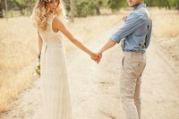 a rustic groom's look with neutral pants, a blue shirt, neutral suspenders and brown boots