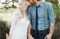 a very relaxed and rustic groom's outfit with navy jeans, a blue chambray shirt, a navy tie, suspenders and a cap