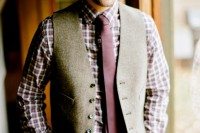 a very relaxed rustic groom's look with brown pants, a plaid shirt, a purple tie and a grey waistcoat