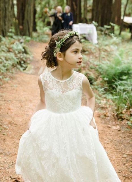 a maxi boho lace flower girl dress with no sleeves and an illusion neckline for an elegant look