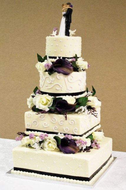 Wedding Cakes With Flowers Between The Tiers