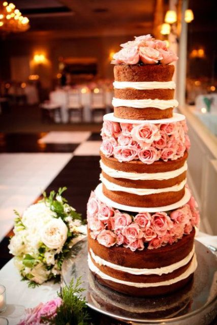 a good looking naked floral wedding cake