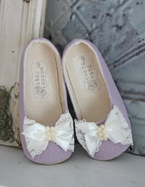 purple flats with white fabric bows and pearls are a cool touch of color and girlishness for sure