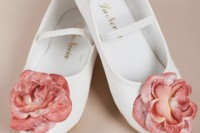white shoes with straps and pink fabric flowers are cool and unusual accessories for a flower girl