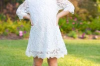a white lace mini dress with a high neckline and short sleeves, floral cowboy boots and a a floral crown for a rustic wedding