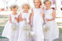 baby's breath pomander balls with velvet ribbon handles is a cute and elegant option