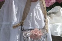 a wire bucket with a burlap handle and a pink fabric bloom for decor