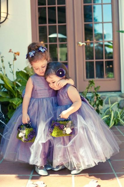 moss baskets with feathers, fabric blooms and beads is a cool and very whimsy idea