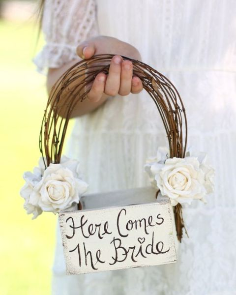 a box with a vine handle and white roses for a rustic and vintage wedding