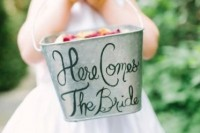 a bucket with calligraphy is a cool and easy idea for a rustic wedding