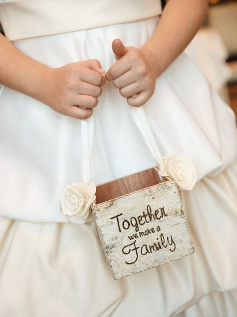 a plywood box covered with bark, a ribbon handle and fabric blooms for a rustic wedding