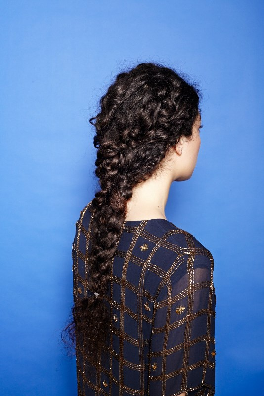a curly long braids coming into a single braid is a whimsy and very boho chic idea