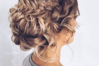 a low bun with a double braided halo and some curls down is a long-lasting option to go for