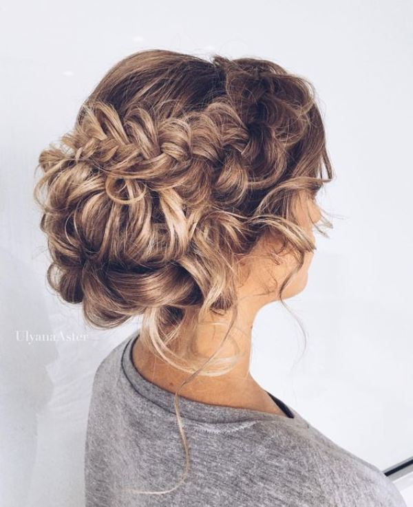 a low bun with a double braided halo and some curls down is a long lasting option to go for