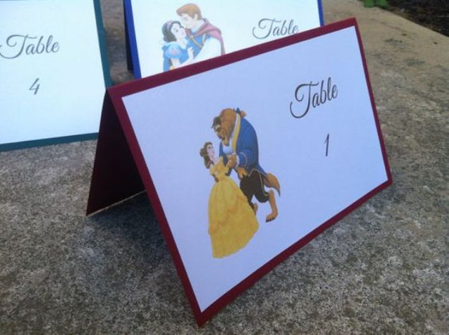 the Beauty and the Beast wedding table numbers are a fun idea for a Disney-themed wedding