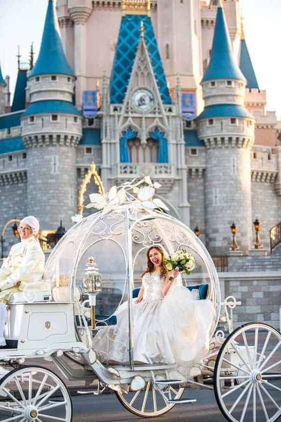 Disney bride in a carriage in the Disneyland   go there for your wedding portraits