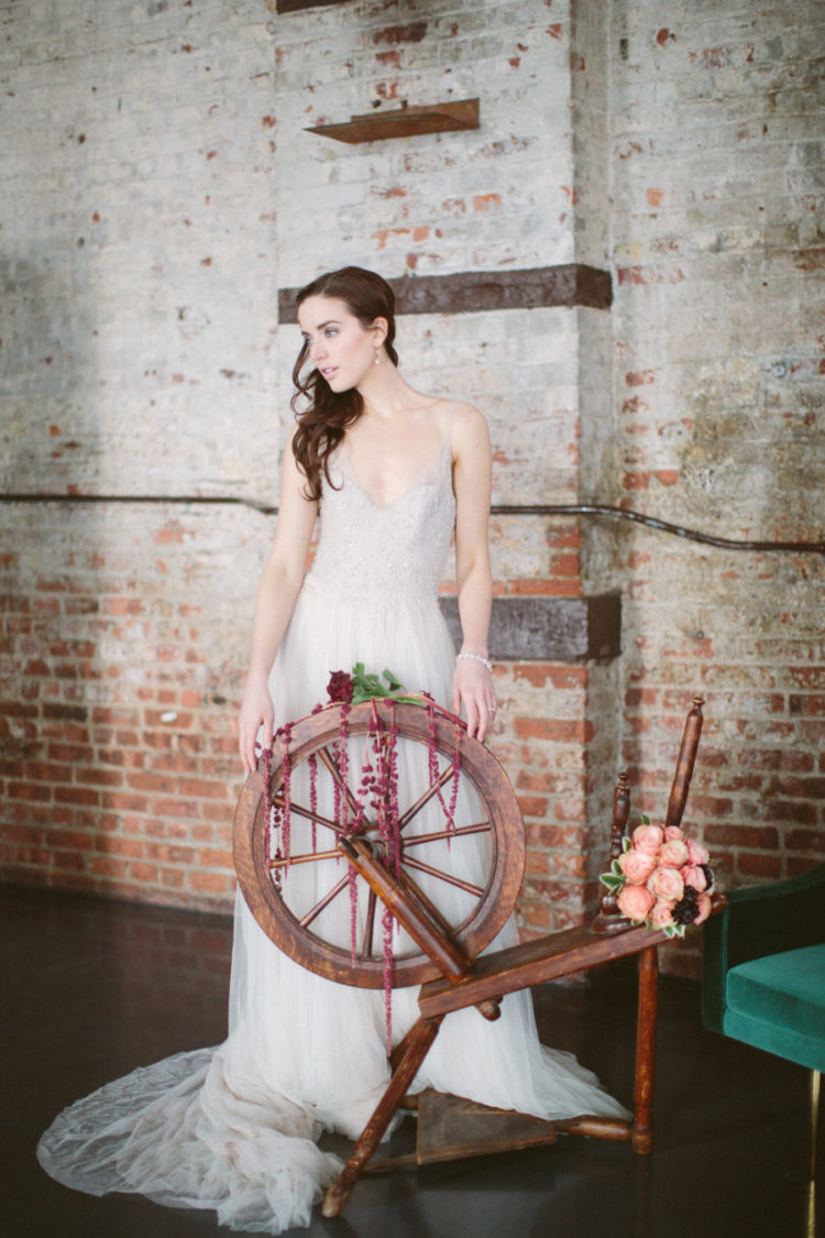 Sleeping Beauty themed bridal shot with a spinning wheel placed in the lounge